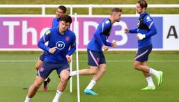 England defender Harry Maguire (left) is fit to return against Scotland Creator: JUSTIN TALLIS
