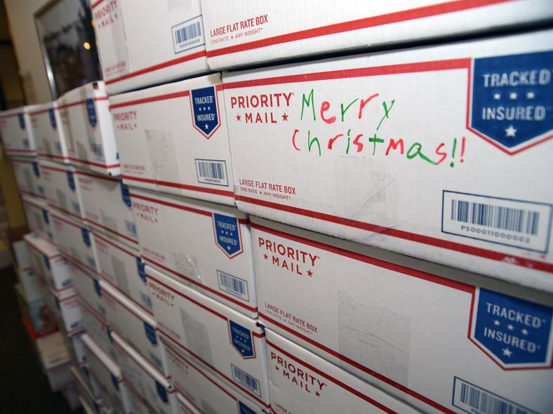 Stacks of care packages wait to be mailed to deployed members of the Iowa Air National Guard. These were packed by a local high school student council and employees of a local bank.