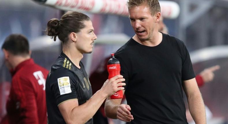 Bayern Munich head coah Julian Nagelsmann (R) speaks to Marcel Sabitzer, who made his club debut at Leipzig on Saturday Creator: Ronny HARTMANN