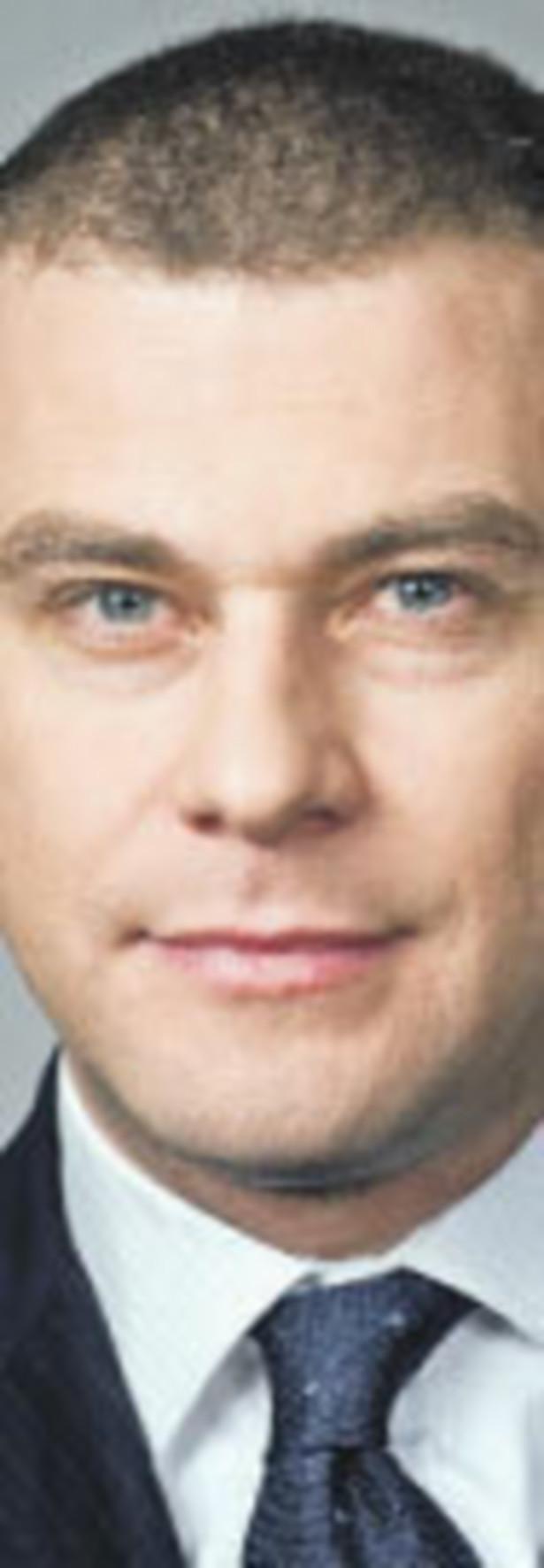 Łukasz Hejmej, adwokat w CMS Cameron McKenna Dariusz Greszta