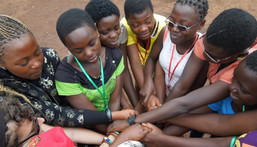 African girls holding hands to signify peace
