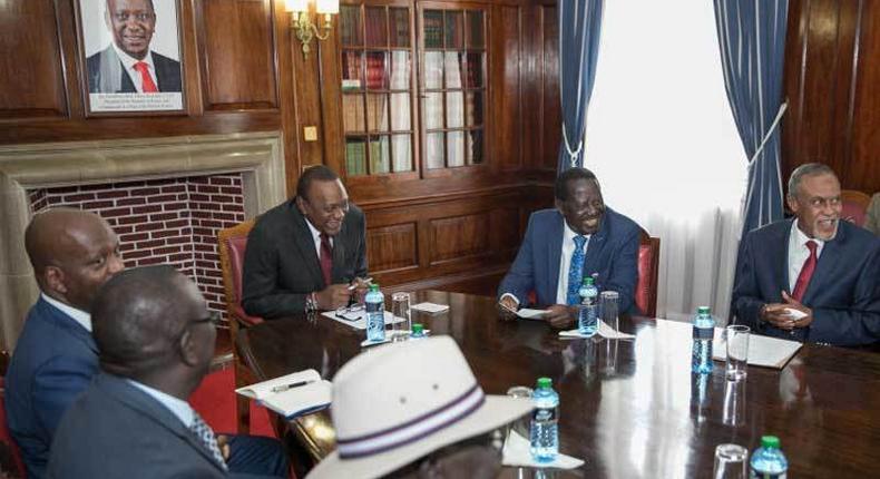 President Uhuru Kenyatta and Raila Odinga with members of the Building Bridges Initiative taskforce at State House