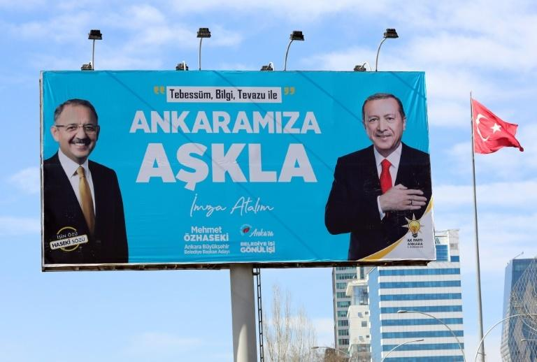 AKP candidate Mehmet Ozhaseki (L) faces a challenge in the race for mayor of the Turkish capital