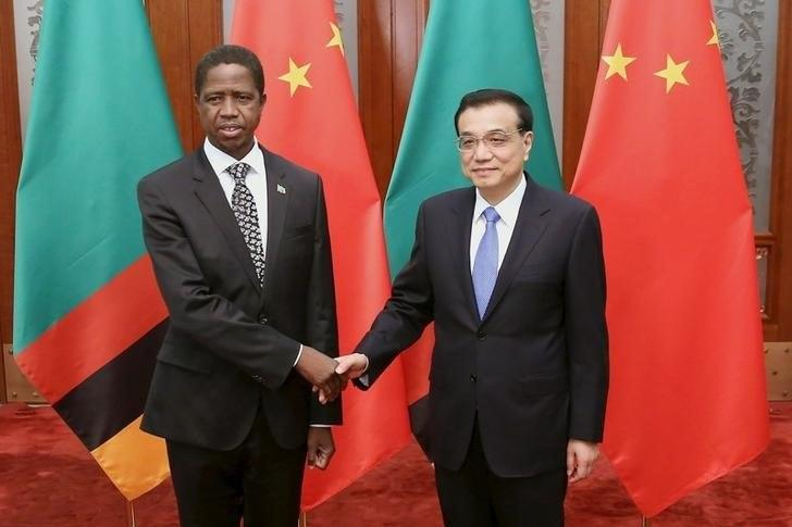 Chinese Premier Li Keqiang (R) shakes hands with Zambia's President Edgar Chagwa Lungu at the Great Hall of the People in Beijing March 30, 2015. REUTERS/Feng Li/Pool