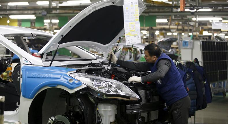 A worker works at an assembly line of Hyundai Motor's plant in Asan.