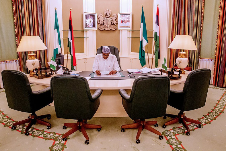 President Buhari in his office. He has a new cabinet on his mind, surely (Presidency)