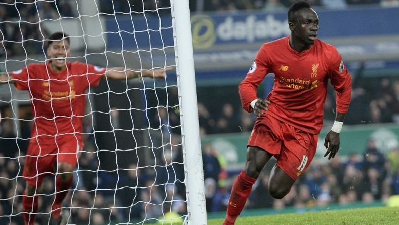 Liverpool's Senegalese midfielder Sadio Mane (R) says the squad is strong enough to make up for him playing at African football's showpiece tournament in Gabon