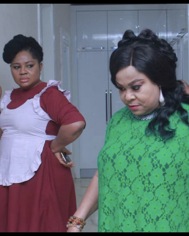 Sola Sobowale is the playing the role of Madam Grace and the boss to Rita Daniels in the movie, 'The Enemy I know.' [Instagram/Rita Daniels]