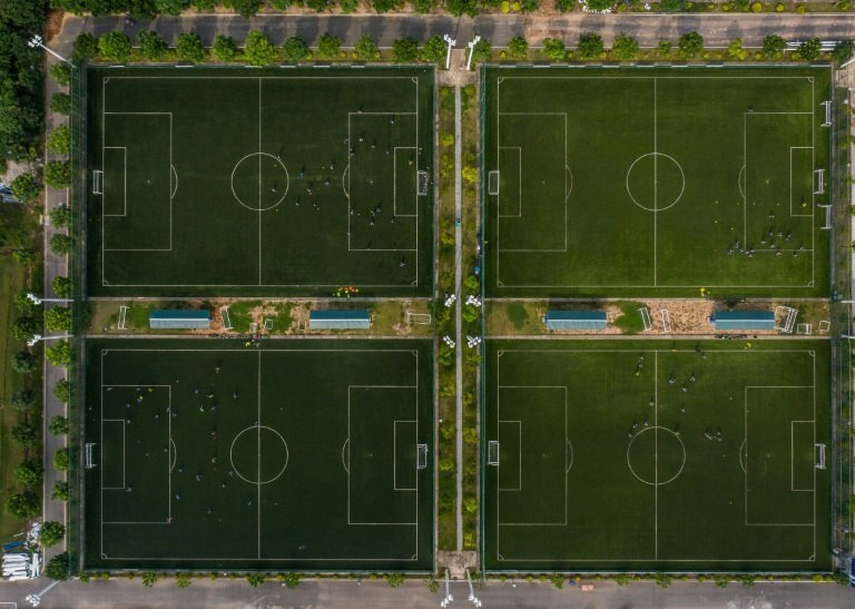 This aerial picture shows pitches of the Guangzhou R&F Football Academy in Meizhou in southern China's Guangdong province ctreated in partnership with Dutch giants Ajax