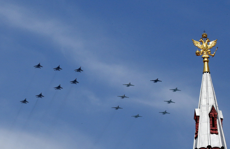 Russian MIG-29 and SU-25 military jets fly in formation during the Victory Day parade above Red Square in Moscow