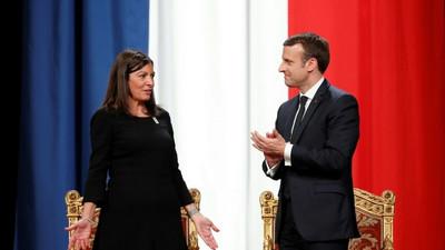 Macron vows full backing for Paris bid