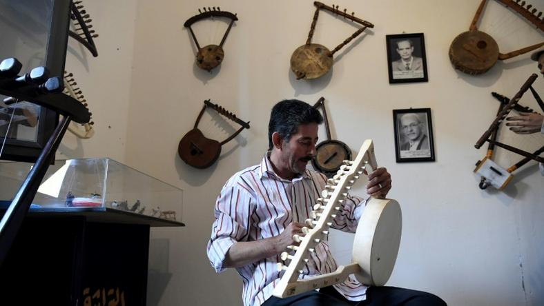 Egyptian craftsman Mohamed Ghaly adds the finishing touches on a semsemia that he made at the Canal 20 cultural museum in Port Said which he founded to pass on the musical heritage to a new generation