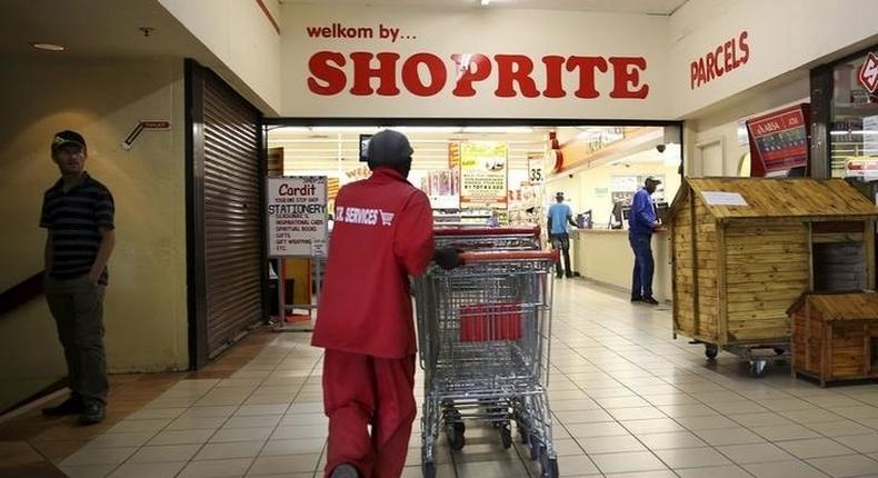 A worker pushing trolleys at Shoprite.
