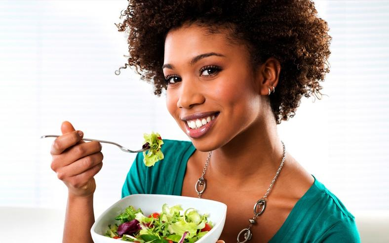 Woman eating vegetables(ebony)