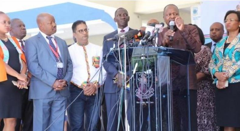 File image of Health CS Mutahi Kagwe addressig the press flanked by other senior government officials