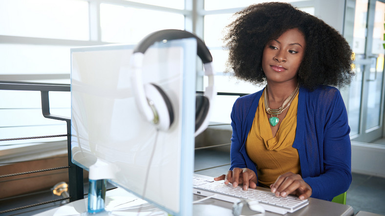 Woman working in office(MadameNoire)