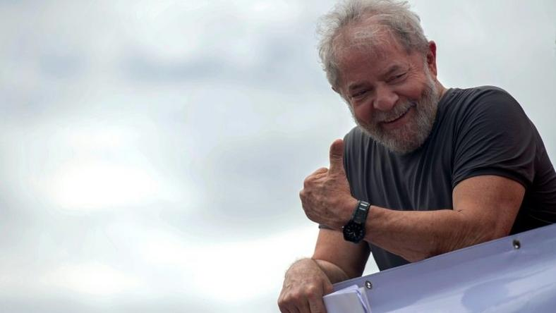 Former Brazilian president Luiz Inacio Lula da Silva gives the thumbs-up to supporters at a rally in Itaborai, Rio de Janeiro state, in December 2017