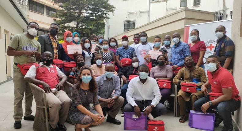 Group photograph of officials of the Red Cross Society of Nigeria and the International Committee of Red Cross with the journalists trained on first aid in Lagos.