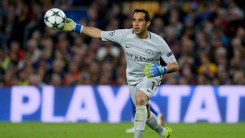 0da27673b90 Manchester City s Chilean goalkeeper Claudio Bravo throws the ball during  the UEFA Champions League football match
