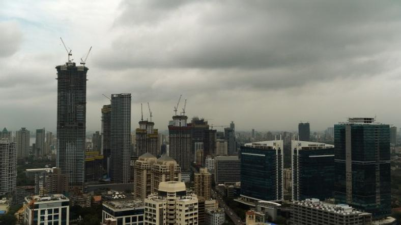 Dark clouds gather over India's financial capital of Mumbai during the monsoon season, when building collapses across the country become more common