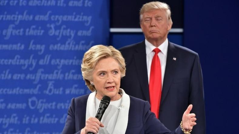 Republican presidential candidate Donald Trump listens to Democratic candidate Hillary Clinton during the second presidential debate in St. Louis, Missouri on October 9, 2016