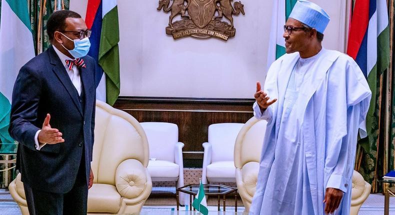 President Muhammadu Buhari and AfDB President Akinwumi Adesina. [Twitter@BashirAhmaad]