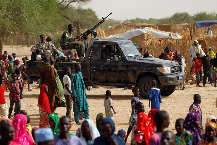 Nigerien soldiers patrol a camp of the city of Diffa during the visit of Niger's Interior Minister M
