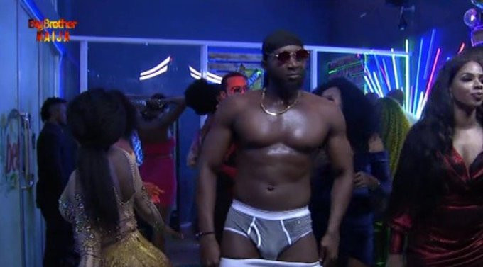 Tuoyo strip teasing housemates at the 14th Saturday Night Party in the BBNaija Pepper Dem house. [Twitter/BBNaija]
