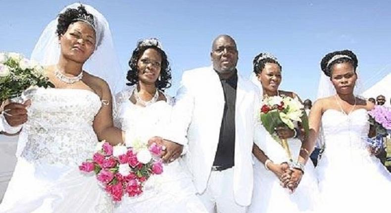 A happy groom with his brides
