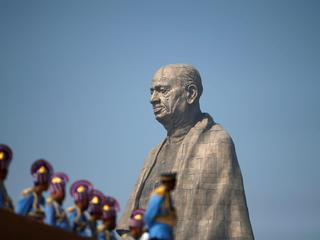 "Police officers stand near the ""Statue of Unity"" portraying Sardar Vallabhbhai Patel, one of the fou"
