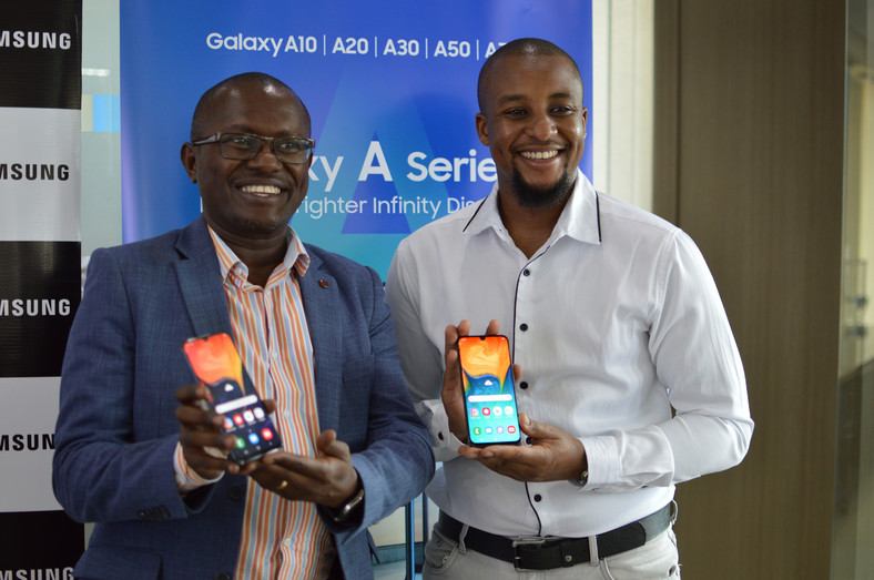 Samsung Electronics East Africa Head  of Internet and Mobile department Charles Kimari (left) and Ryan Mule, Product Marketing Manager Samsung Electronics East Africa (right) during the launch of the galaxy A series phone  into the Kenyan market.
