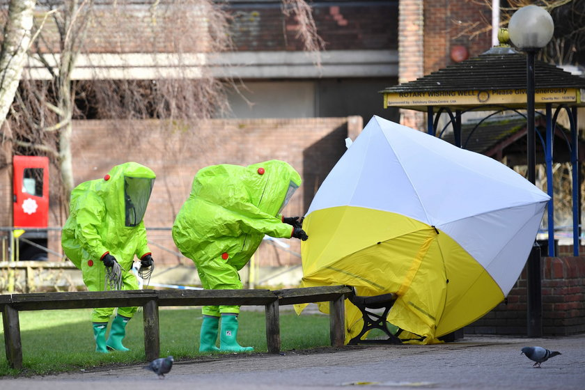 Police officers continue to guard the scene where a forensic tent, covering the bench where Sergei S