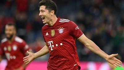 Lewandowski hits hat-trick to pass 300 goals for Bayern Munich