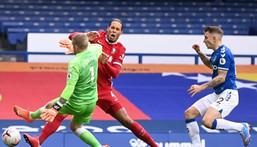 Painful clash: Virgil van Dijk clashed with Everton goalkeeper Jordan Pickford in the Merseyside derby last October Creator: Laurence Griffiths