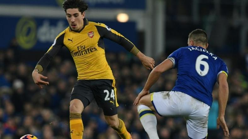 Arsenal's Hector Bellerin (L) fights for the ball with Everton's Phil Jagielka during their English Premier League match, at Goodison Park in Liverpool, on December 13, 2016