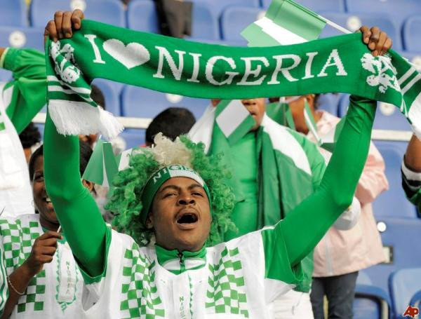 An illustrative photo of a Nigerian football fan cheering the Super Eagles