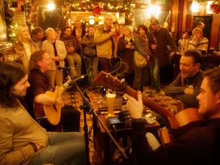 Musicians playing live in a Dublin pub