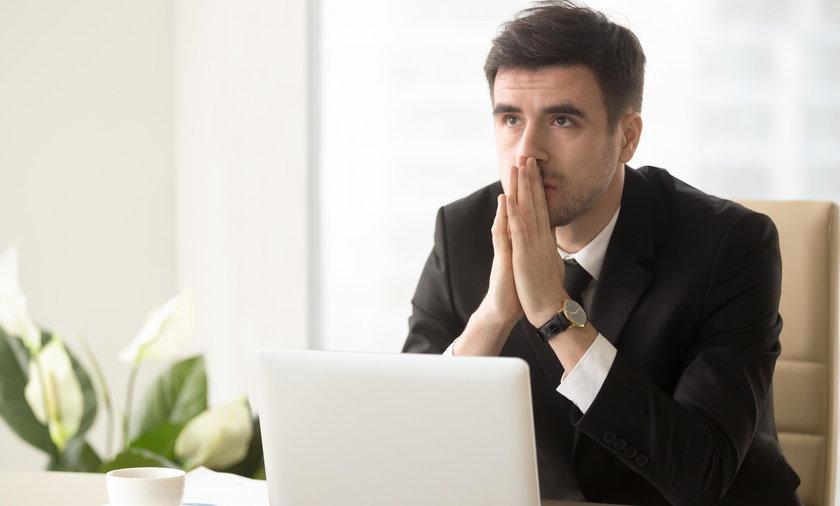 Pensive entrepreneur pondering serious problem