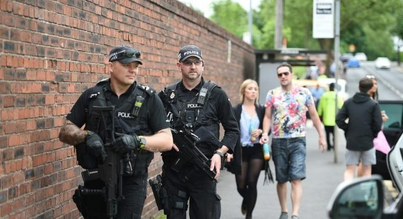 Armed police officers stand guard in Manchester, northwest England, on May 27, 2017