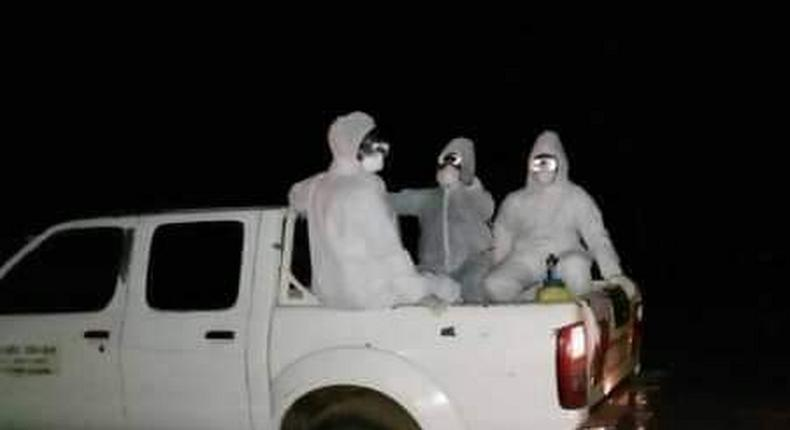 File image of public health officers during a night funeral for a Covid-19 victim  in Siaya County