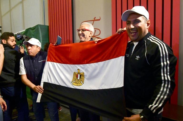 Egyptian representatives celebrate in Dakar after the Confederation of African Football (CAF) executive committee's decision to choose Egypt to host the 2019 Africa Cup of Nations (AFP)