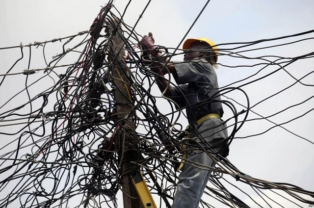 An electricity staff on duty (Guardian)
