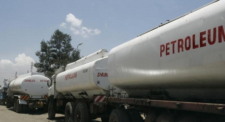 Trucks transporting oil, petrol and gas wait to reload outside a depot in the outskirts of Nairobi September 30, 2008.   REUTERS/Antony Njuguna
