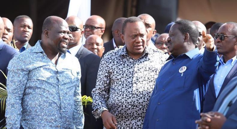 File image of President Uhuru Kenyatta (center), African Union Envoy Raila Odinga and Muhoroni MP Onyango Koyoo