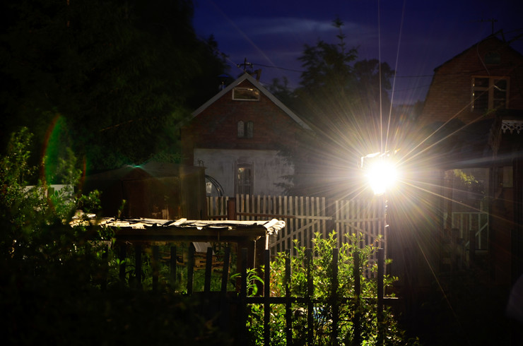 dvoriste stock-photo-fence-in-the-backyard-lights-from-spotlight-at-night-country-side-589872173