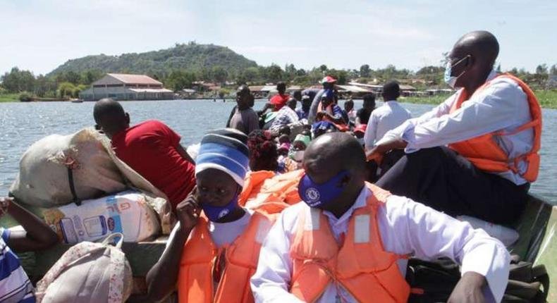 File image of a boat ferrying passengers and goods on Lake Victoria
