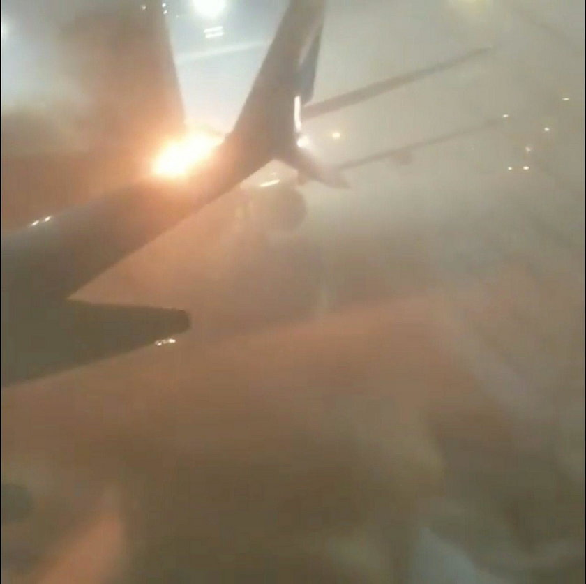 An explosion is seen through a window of a plane that has collided with another plane at Toronto's P