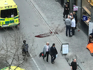 Ambulance in a street near the site were a truck was driving into a crowd in central Stockholm