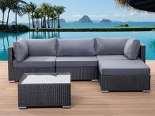 Beliani Rattanowe meble ogrodowe z poduszkami - sofa rattan w kolorze czarnym -