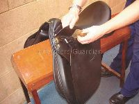 th_34227_cleaning_a_saddle.jpg